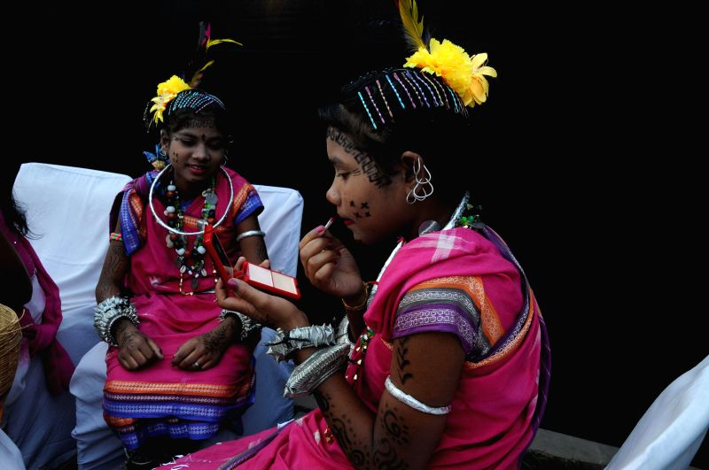 Tribal artists get ready ahead of a performance at the National Tribal Festival at New Delhi's Connaught Place on Feb 15, 2015.
