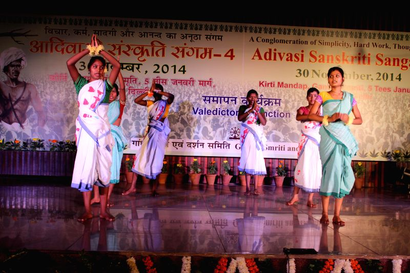 Tribals perform during the concluding ceremony of the three-day long Adivasi Sanskriti Sangam - 2014 in New Delhi on Nov 30, 2014.