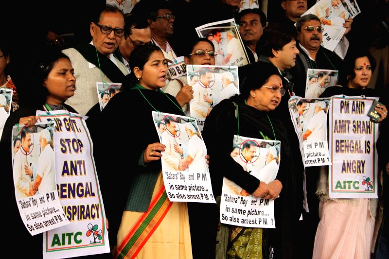 Trinamool Congress MPs stage a demonstration at the Parliament premises in in New Delhi, on Dec 15, 2014.