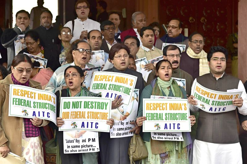 Trinamool Congress MPs stage a demonstration at the Parliament premises in New Delhi, on Dec 16, 2014.