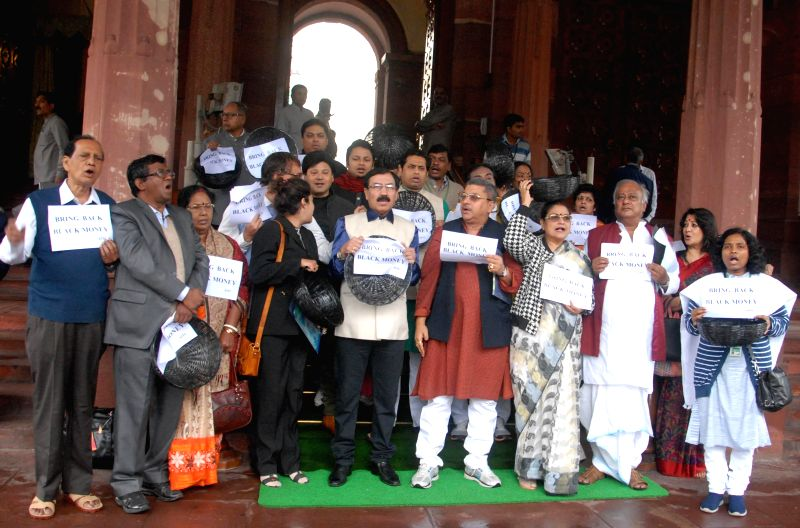 Trinamool MPs stage a demonstration at the Parliament premises in New Delhi, on March 2, 2015.