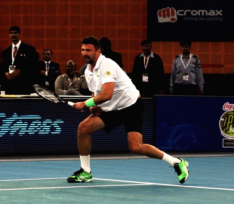 UAE Royals Goran Ivanisevic in action during his men's singles match against Singapore Slammers Patrick Rafter on the Coca-Cola International Premier Tennis League (IPTL) at IG Indoor ...