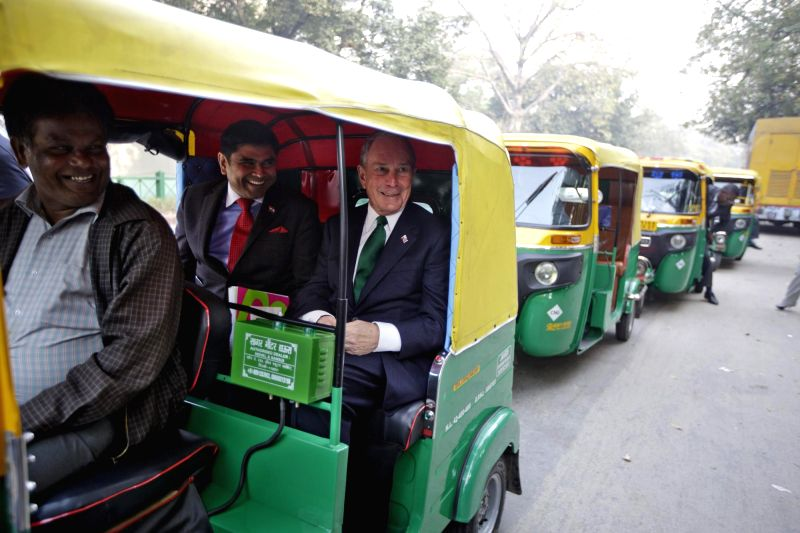 UN Secretary-General`s Special Envoy for Cities and Climate Change Michael R. Bloomberg rides a CNG auto rickshaw to the RE-Invest Forum in New Delhi on Feb. 16, 2015.