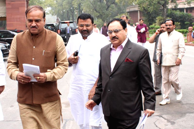 Union Chemicals and Fertilizers Minister Ananth Kumar and the Union Minister for Health and Family Welfare Jagat Prakash Nadda arrive at the Parliament to attend BJP parliamentary party ... - Ananth Kumar