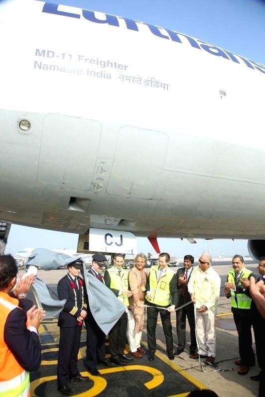 Union Civil Aviation Minister Ashok Gajapathi Raju names MD-11 freighter aircraft of Lufthansa Cargo as `Namaste India` during a programme at the Indira Gandhi International (IGI) Airport ... - Ashok Gajapathi Raju and Indira Gandhi International