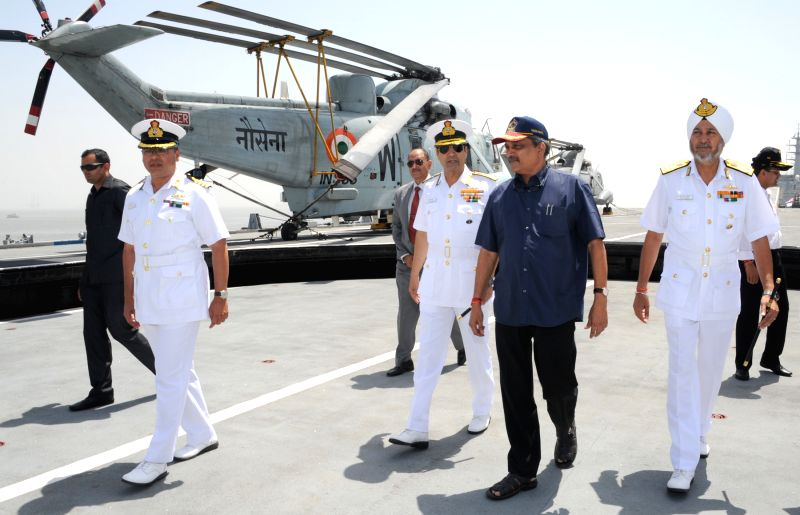 Union Defence Minister Manohar Parrikar visits the Headquarters, Western Naval Command, in Mumbai on April 6, 2015. Also seen the Chief of Naval Staff, Admiral R.K. Dhowan and the Flag ...