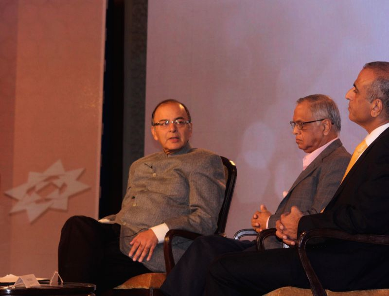 Union Finance Minister Arun Jaitley, Founder, Infosys N R Narayana Murthy and Founder, chairman and Group CEO of Bharti Enterprises Sunil Bharti Mittal at the India Economic Conclave in ...