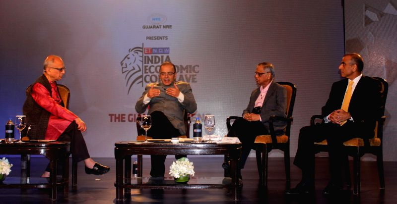 Union Finance Minister Arun Jaitley, Founder, Infosys N R Narayana Murthy, Founder, chairman and Group CEO of Bharti Enterprises Sunil Bharti Mittal with Journalist Swaminathan S. ...