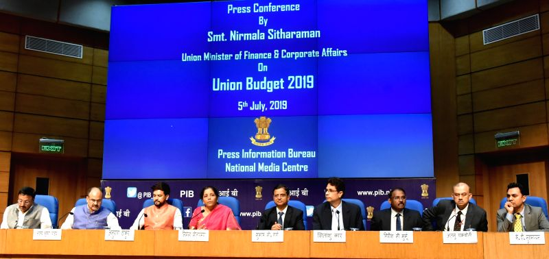 New Delhi: Union Finance Minister Nirmala Sitharaman addresses a Post Budget Press Conference, in New Delhi on July 5, 2019. Also seen Union MoS Finance Anurag Singh Thakur and Finance Secretary S.C. Garg. (Photo: IANS/PIB)