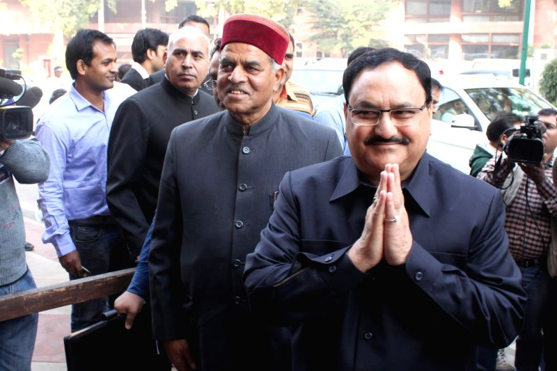 Union Health Minister J.P Nadda arrives at the Parliament House to attend the first day of Parliament's winter session in New Delhi, on Nov 24, 2014. - J.