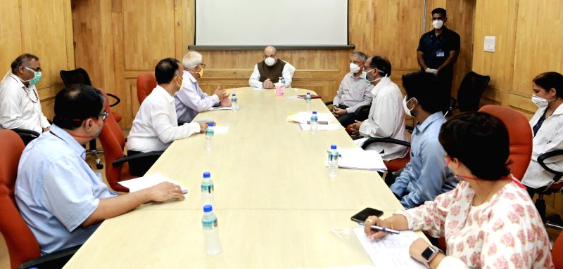 New Delhi: Union Home Minister Amit Shah chairs a meeting to review arrangements related to COVID-19 during his surprise visit to Lok Nayak Jay Prakash Narayan (LNJP) Hospital, in New Delhi on June 15, 2020. (Photo: IANS/PIB)