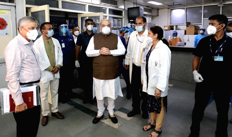 New Delhi: Union Home Minister Amit Shah on a surprise visit to Lok Nayak Jay Prakash Narayan (LNJP) Hospital to review the arrangements related to COVID-19, in New Delhi on June 15, 2020. (Photo: IANS/PIB)