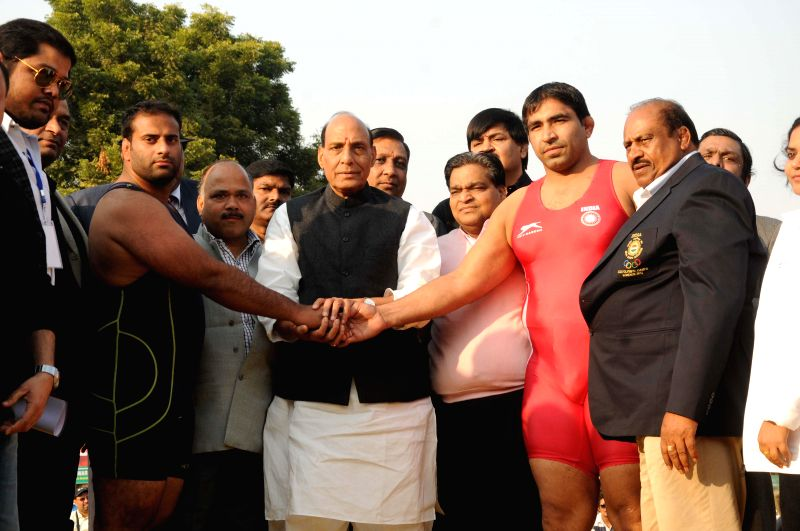 Union Home Minister Rajnath Singh during the inauguration of Grand Wrestling Championship in New Delhi, on Nov 23, 2014.