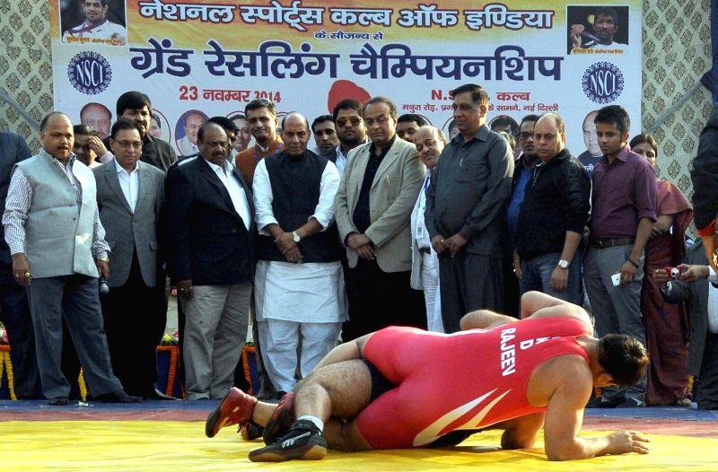 Union Home Minister Rajnath Singh witnesses a wrestling match at the inauguration of Grand Wrestling Championship in New Delhi, on Nov 23, 2014.