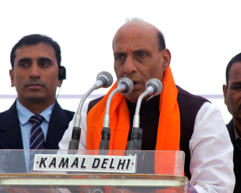 Union Home Minister Rajnath Singh addresses during a programme organised to distribute enhanced compensations to people affected by the 1984 anti-Sikh riots at Widow Colony Tilak Nagar, ...