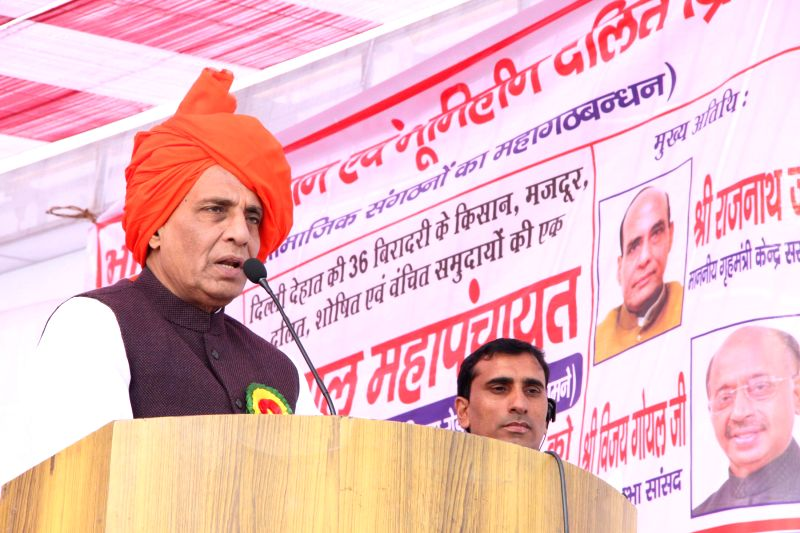 Union Home Minister Rajnath Singh addresses a rally of farmers and landless Dalit peasants, in New Delhi, on Dec 26, 2014.
