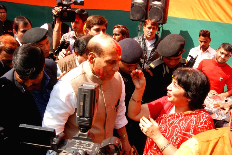 Union Home Minister Rajnath Singh celebrates Holi during a Holi Milan programme organised at BJP office in New Delhi, on March 5, 2015. - Rajnath Singh