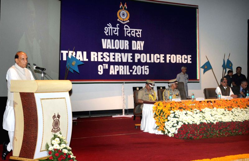 Union Home Minister Rajnath Singh addresses at the CRPF `Valour Day` ceremony, in New Delhi on April 9, 2015. Also seen Minister of State for Home Affairs Haribhai Parathibhai Chaudhary, ... - Prakash Mishra