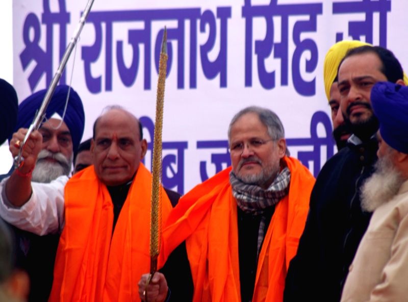 Union Home Minister Rajnath Singh and Delhi Lt Governor Najeeb Jung  during a programme organised to distribute enhanced compensations to people affected by the 1984 anti-Sikh riots at ...