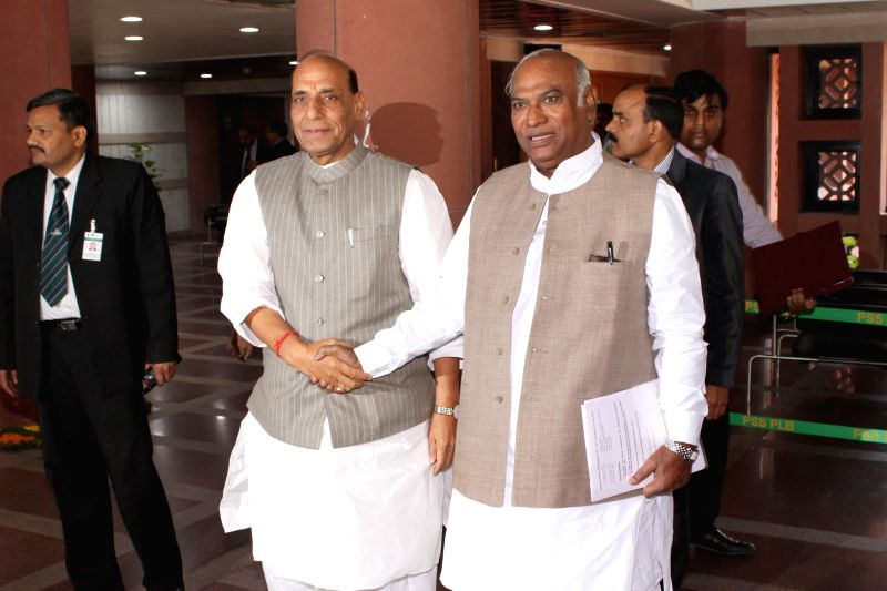 Union Home Minister Rajnath Singh and the leader of the Congress in the Lok Sabha M. Mallikarjun Kharge during an all party meeting in New Delhi on Feb 22, 2015. - Rajnath Singh