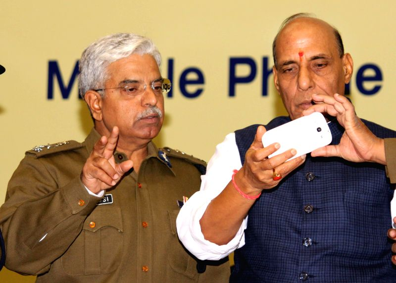 Union Home Minister Rajnath Singh at the launch of Delhi Police's mobile app for public safety - `Himmat`, in New Delhi, on Jan 1, 2015. Also seen Delhi Police Commissioner Delhi Police ...