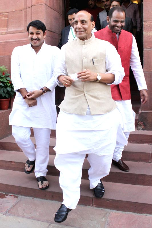 Union Home Minister Rajnath Singh at the Parliament in New Delhi, on March 12, 2015. Also seen BJP MPs Manoj Tiwari and Ramesh Bidhuri. - Rajnath Singh