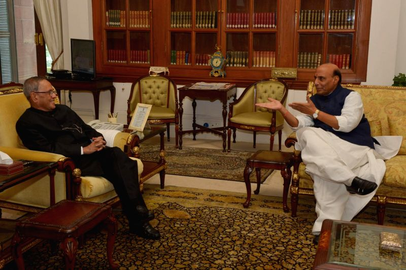 Union Home Minister Rajnath Singh calls on President Pranab Mukherjee to wish him on new year at Rashtrapati Bhavan in New Delhi, on Jan 1, 2015. - Rajnath Singh and Pranab Mukherjee