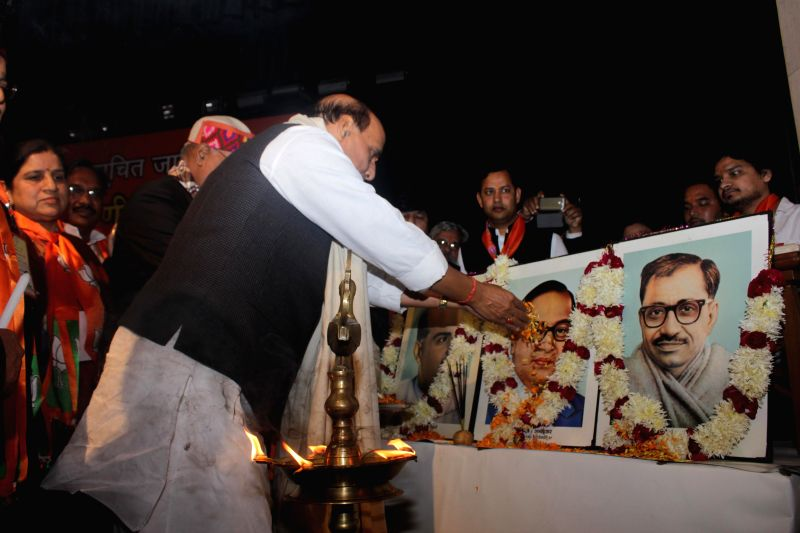 Union Home Minister Rajnath Singh pays tribute during the inauguratation of BJP`s national executive meeting on Schedule Caste Morcha in New Delhi on Jan 3, 2015. - Rajnath Singh