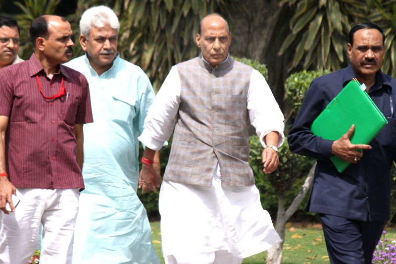 Union Home Minister Rajnath Singh with Union MoS Manoj Sinha at the Parliament in New Delhi, on April 21, 2015. - Rajnath Singh and Manoj Sinha