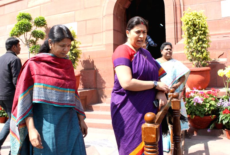 Union HRD Minister Smriti Irani and DMK MP Kanimozhi at the Parliament in New Delhi, on March 16, 2015. - Smriti Irani
