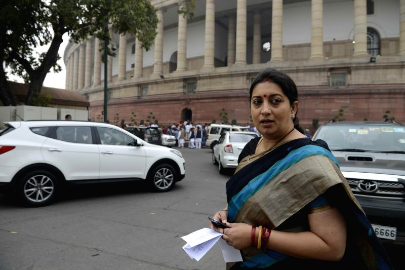 Union HRD Minister Smriti Irani arrives at the Parliament to attend the second day of the budget session of the house in New Delhi, on Feb 24, 2015. - Smriti Irani