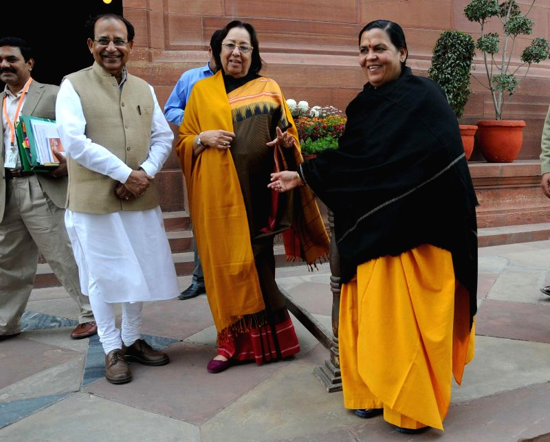 Union Miister for Minority Affairs Dr. Najma A. Heptulla and the Union Minister for Water Resources, River Development and Ganga Rejuvenation Uma Bharti  at the Parliament in New Delhi, on - Najma A. Heptulla