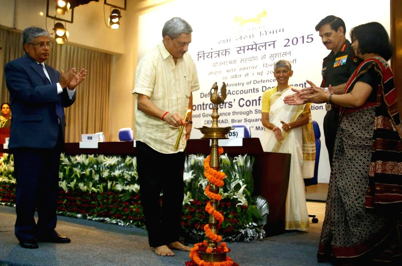 Union Minister for Defence Manohar Parrikar at the inauguration of two-day Controllers' Conference of Defence Accounts Department in New Delhi, on April 30, 2015. Also seen the Chief of ... - Dalbir Singh