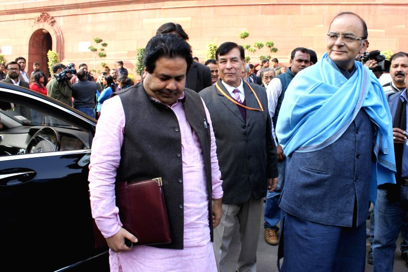 Union Minister for Finance, Corporate Affairs, and Information and Broadcasting Arun Jaitley and Congress MP Rajeev Shukla at the Parliament premises in New Delhi, on Dec 16, 2014.