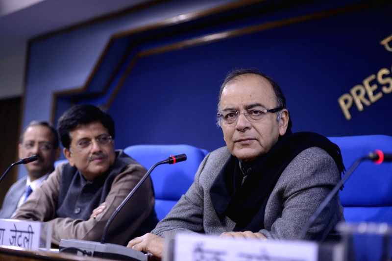 Union Minister for Finance, Corporate Affairs, and Information and Broadcasting Arun Jaitley and Union Minister of State (Independent Charge) for Power, Coal and New and Renewable Energy ..
