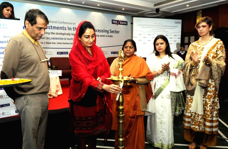 Union Minister for Food Processing Industries Harsimrat Kaur Badal lights the lamp at the National Conference on Spurring, Financing and Investments in the Food Processing Sector, in New .. - Suresh Prabhakar Prabhu