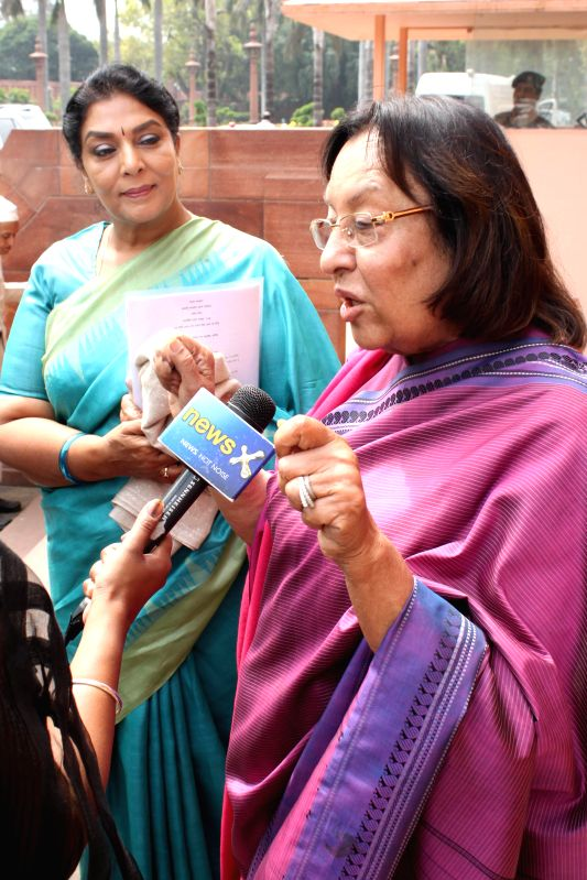Union Minister for Minority Affairs Najma Heptullah with Congress leader Renuka Chaudhary at the Parliament in New Delhi, on March 13, 2015. - Najma Heptulla and Renuka Chaudhary
