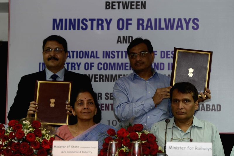 Union Minister for Railways Suresh Prabhakar Prabhu and the Minister of State for Commerce and Industry (Independent Charge) Nirmala Sitharaman witness the signing of a Memorandum of ... - Suresh Prabhakar Prabhu