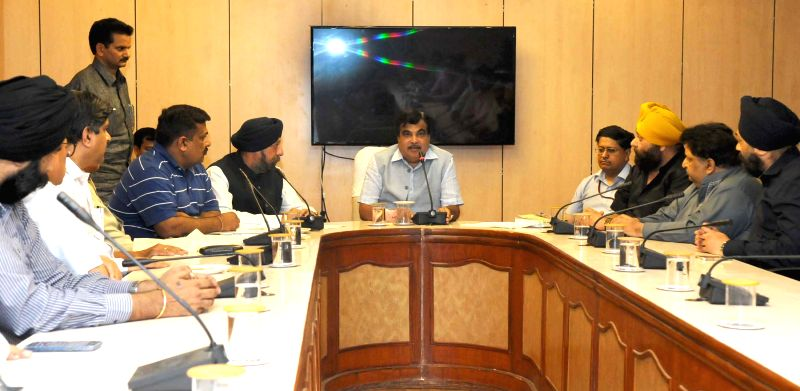 Union Minister for Road Transport and Highways and Shipping Nitin Gadkari meets the members of Transporters Association, in New Delhi on April 13, 2015.