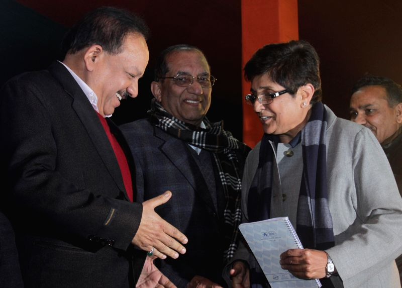 Union Minister for Science and Technology and Earth Sciences Dr. Harsh Vardhan greets new joined party leader Kiran Bedi in New Delhi, on Jan 16, 2015.
