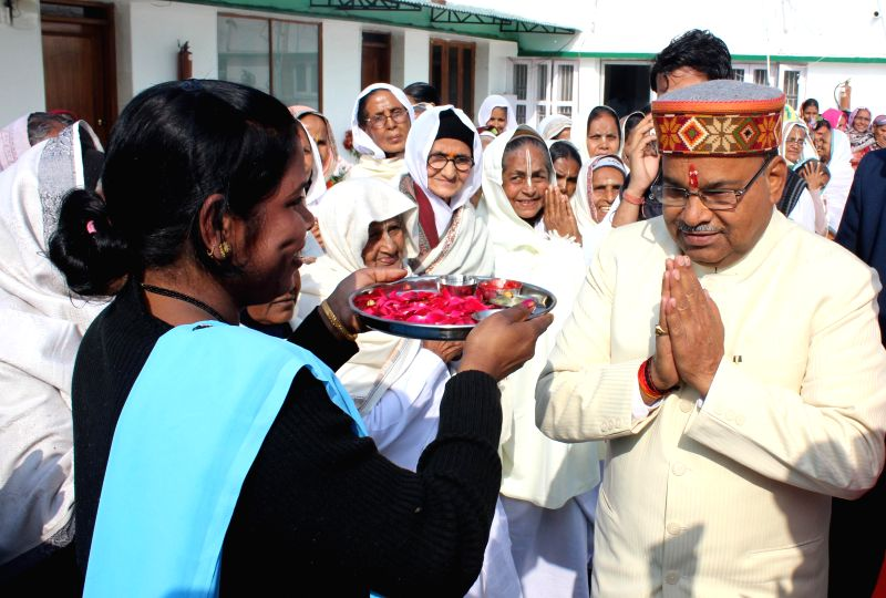 Union Minister for Social Justice Thavar Chand Gehlot being welcomed during his visit to  Sulabh Gram in New Delhi, on Jan 5, 2015.