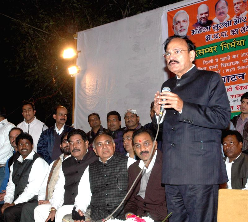 Union Minister for Urban Development, Housing and Urban Poverty Alleviation and Parliamentary Affairs, M Venkaiah Naidu addresses at the inauguration of the CCTV system, at Sector 1, R.K. .