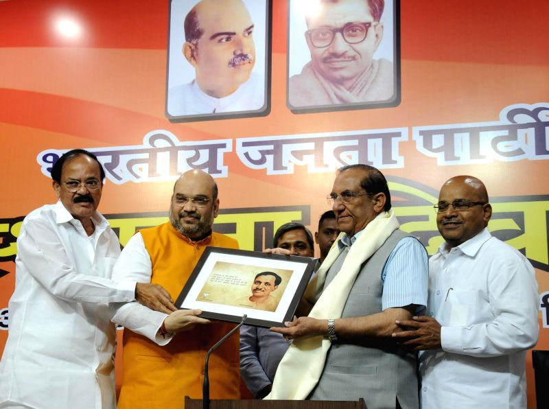 Union Minister for Urban Development, Housing and Urban Poverty Alleviation and Parliamentary Affairs M. Venkaiah Naidu, BJP chief Amit Shah with BJP leaders Vijay Kumar Malhotra and BJP ... - M. Venkaiah Naidu, Amit Shah and Vijay Kumar Malhotra