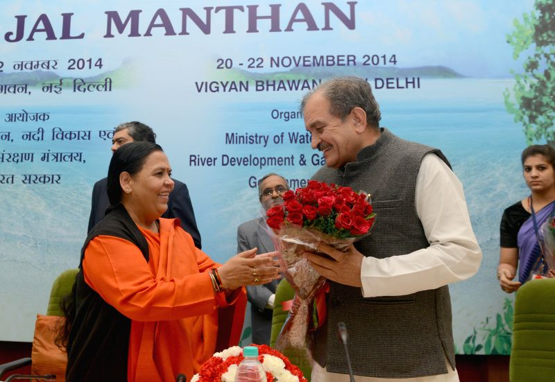 Union Minister for Water Resources, River Development and Ganga Rejuvenation Uma Bharti with Union Minister for Rural Development Birender Singh at the ``Jal Manthan``, a National ... - Development Birender Singh