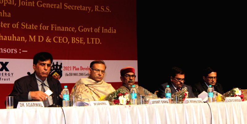 Union Minister of State for Finance Jayant Sinha, RSS leader Krishna Gopal, Bombay Stock Exchange MD Ashish Chauhan and others during a seminar on `Our Role in Current Indian Scenario` ... - Ashish Chauhan