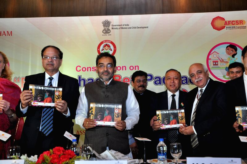 Union Minister of State for Human Resource Development Upendra Kushwaha, Secretary Ministry of Women and Child Development V S Oberoi, ASSOCHAM Secretary General D.S. Rawat, and others at .
