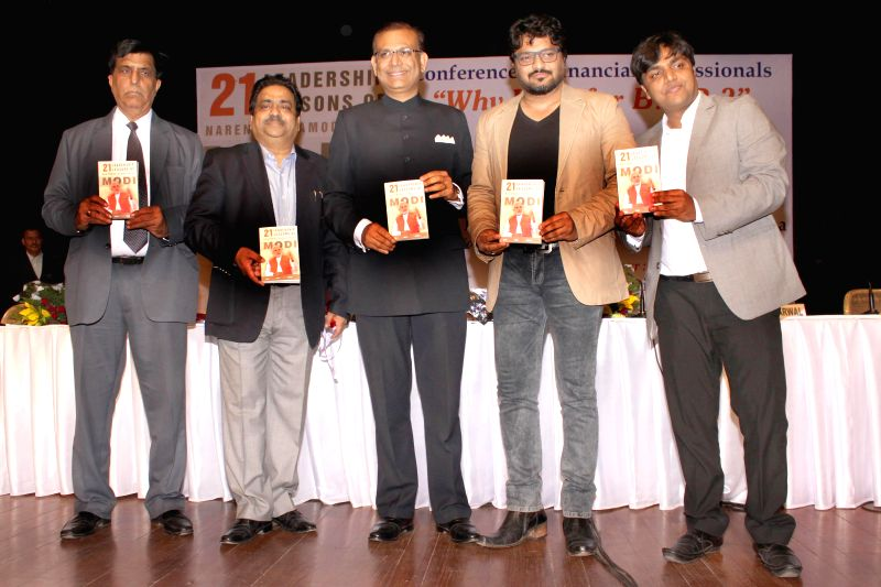 Union Minister of State,Urban Development,Babul Supriyo and Union Minister of State , Finance,Jayant Sinha during the release of book ``21 Leadership Lessons of Narendra Modi``, in New ... - Jayant Sinha