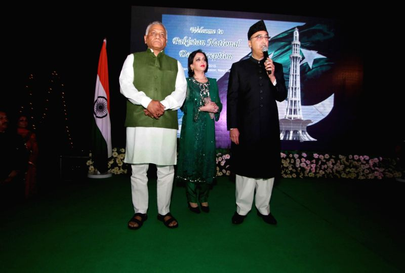 Union Minister of States for External Affairs Gen VK Singh with the Pakistan High Commissioner to India Abdul Basit during a programme organised at the Pakistan High Commission on Pakistan ...