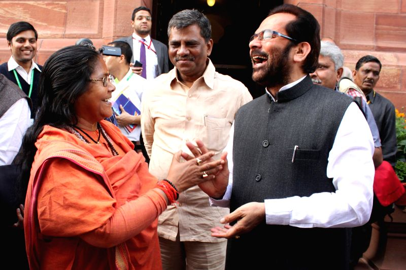 Union Ministers Sadhvi Niranjan Jyoti and Mukhtar Abbas Naqvi at the Parliament House after the first day of the budget session in New Delhi, on Feb 23, 2015. - Sadhvi Niranjan Jyoti and Mukhtar Abbas Naqvi