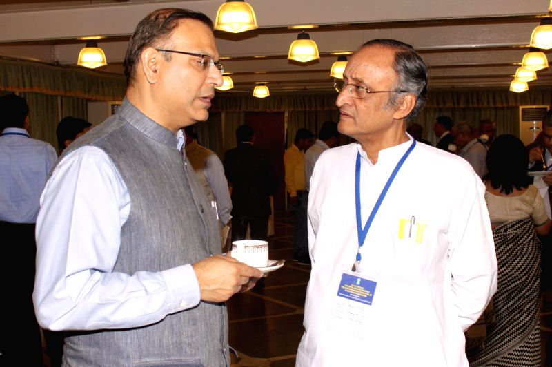 Union MoS Finance Jayant Sinha and West Bengal Finance Minister Amit Mitra during a meeting with the Finance Ministers of State and Union Territories in New Delhi on March 20,2015. - Amit Mitra and Jayant Sinha